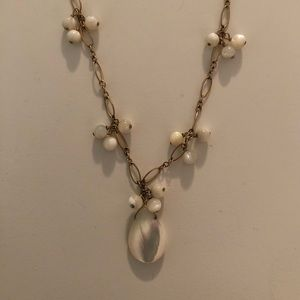 Gold necklace with white beads